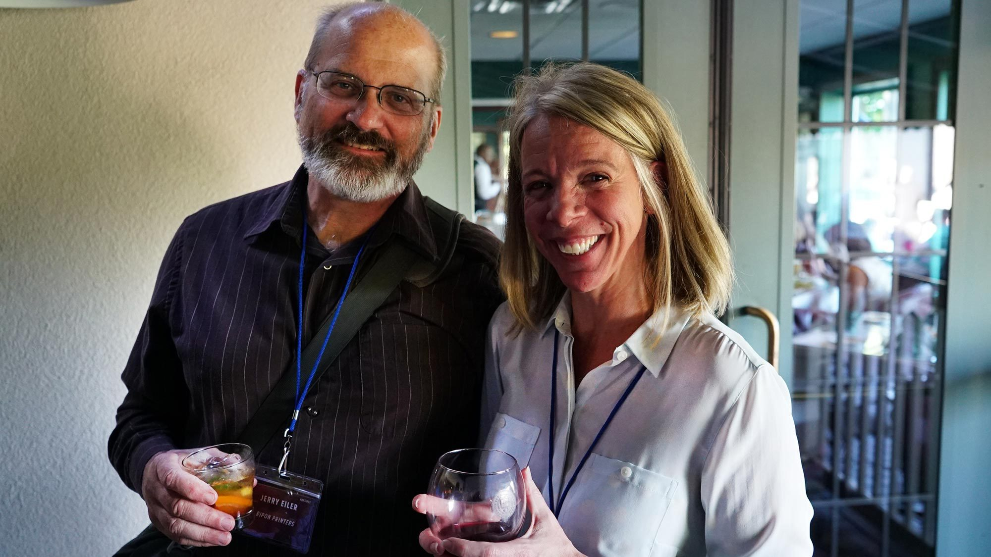 Jerry Eiler (left) and BCC Software's Dina Ergood enjoying some beverages after a successful day of presentations.