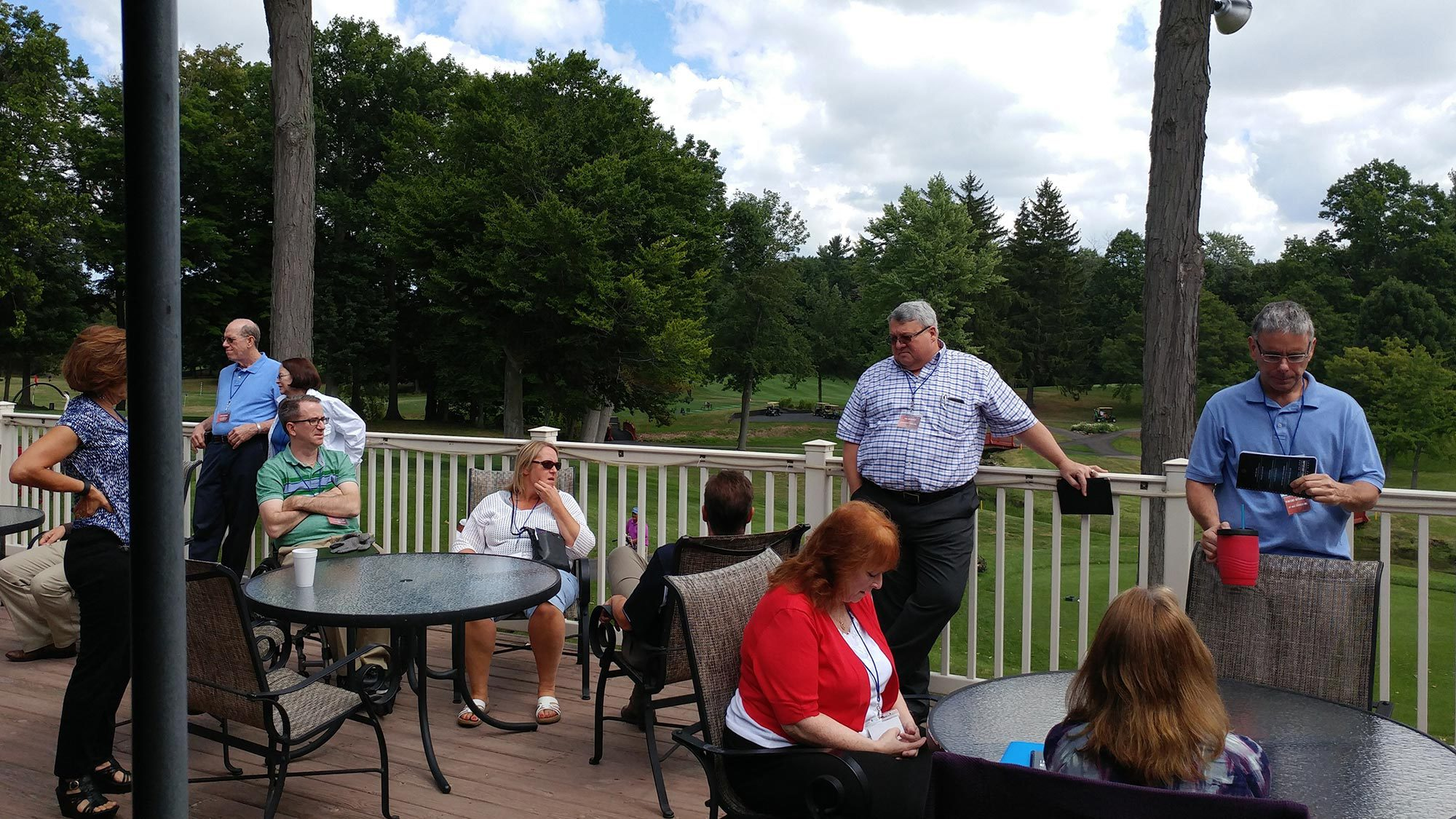 Attendees enjoy the perfect views at Brook-Lea Country Club during a session break.