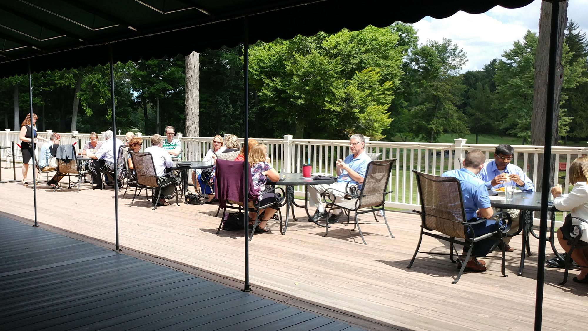 Attendees enjoy lunch on the deck.