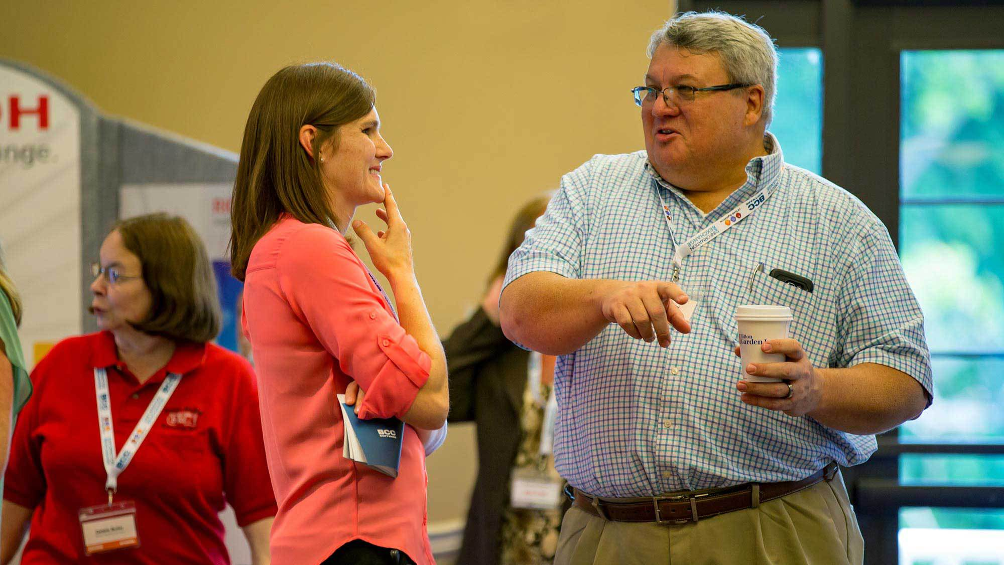 BCC Software customers Barb Wegner and Joe Murphy chatting at the Meeting Zone.