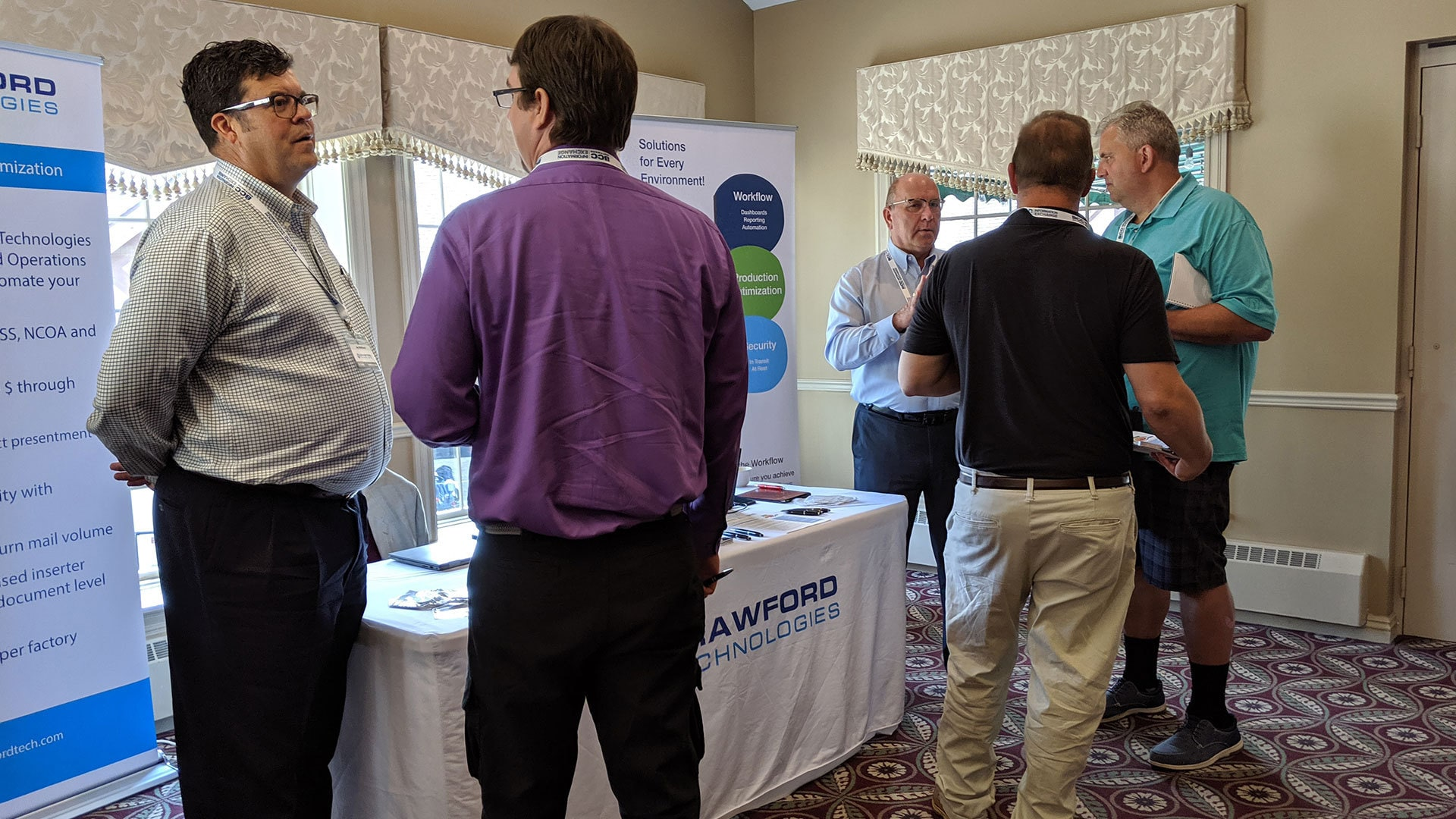 Attendees and Sponsor Crawford Technologies in the IE Meeting Zone